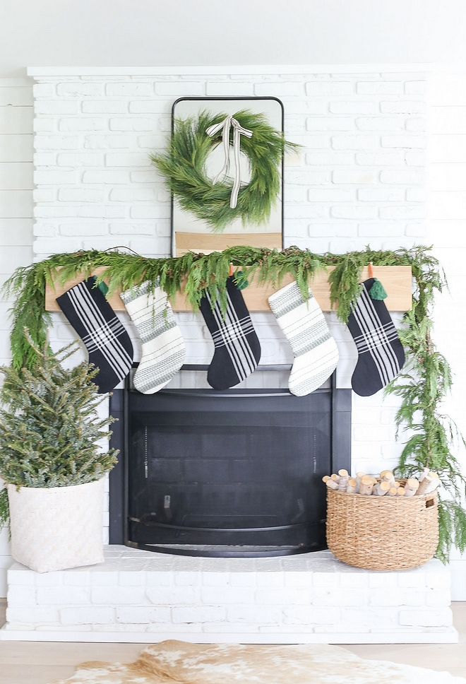 Painted brick fireplace with White oak mantel The White Oak mantel was custom-designed by the homeowner and it looks great against the painted brick #Paintedbrickfireplace #Whiteoakmantel