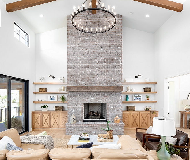 Gray Brick Fireplace Gray Brick Fireplace At first, the designer had planned to paint the fireplace brick white but changed her mind after seeing how much character this gray-ish brick brings to the space #Brickfireplace #Graybrickfireplace