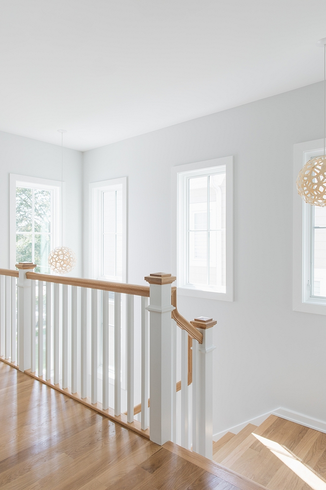 Sherwin Williams Extra White Window trim Staircase spindles Sherwin Williams Extra White Trim Paint color #SherwinWilliamsExtraWhite