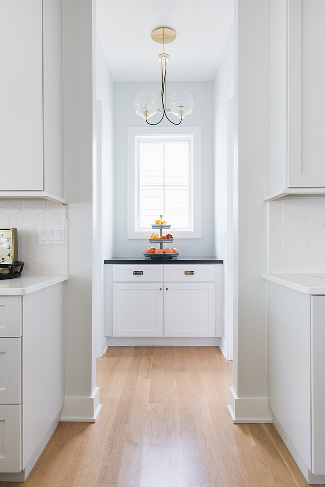 Butler's Pantry A custom cabinet is located on a hall that leads to the mudroom and pantry area #cabinet #ButlersPantry