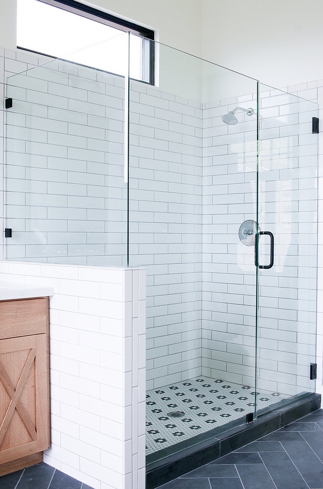 Shower with white subway tile on walls and Hex Matte White with Flower tile on flooring #subwaytile #HexMatteWhite #flowertile #flooring #showertile #shower #tile