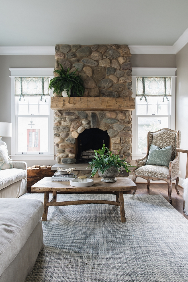 River Rock Fireplace Fireplace features natural River Rock stone and a chunky beam mantel River Rock Fireplace How to update River Rock Fireplace Just add a chunky beam mantel for an updated look #RiverRockFireplace #Fireplaceupdate #Fireplacereno #chunkymantel #chunkybeam