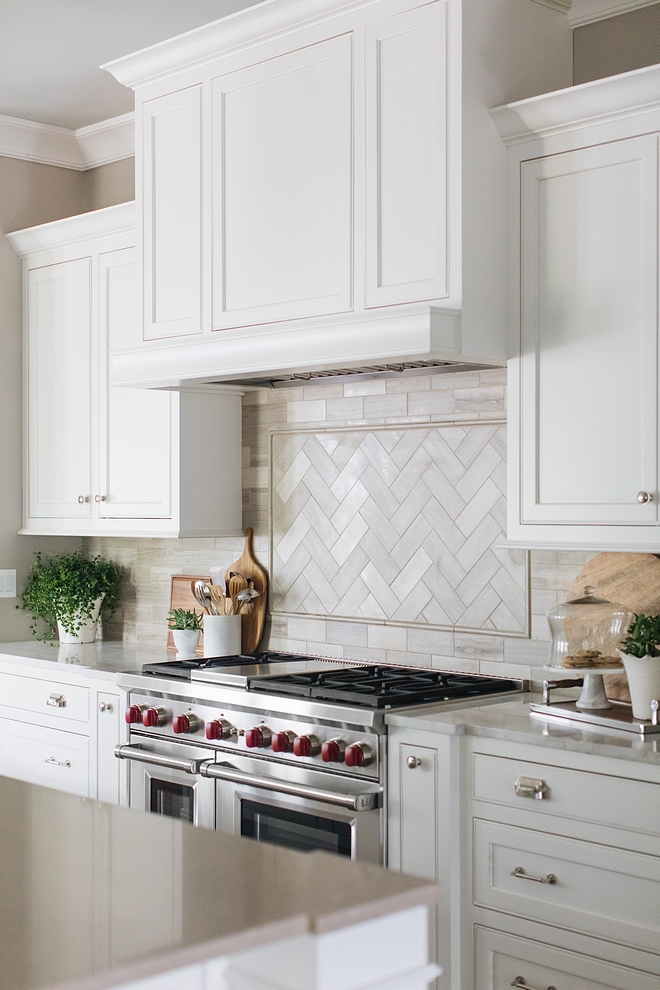 White kitchen inset cabinet painted in White Dove by Benjamin Moore with Limestone blacksplash tile in herringbone pattern above range White kitchen inset cabinet painted in White Dove by Benjamin Moore #Whitekitchen #insetcabinet #kitcheninsetcabinet #WhiteDovebyBenjaminMoore
