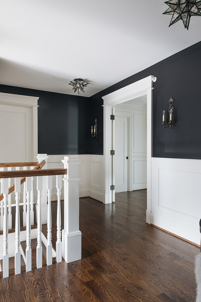Wainscoting is painted in Benjamin Moore Decorator's White and Walls above waiscoting are painted Benjamin Moore Black #wainscoting #paintcolors #Benjaminmoore #balckandwhite