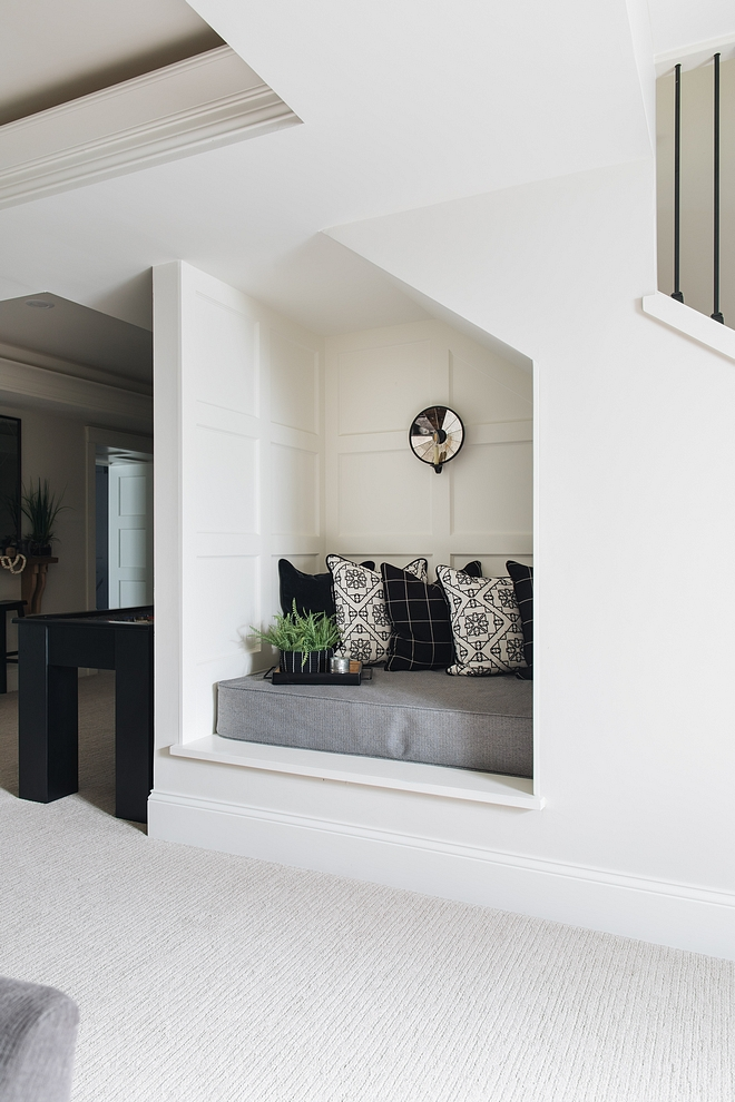 Reading Nook Located under the staircase, this adorable reading nook features grid board and batten #readingnook #baordandbatten #gridboardandbatten