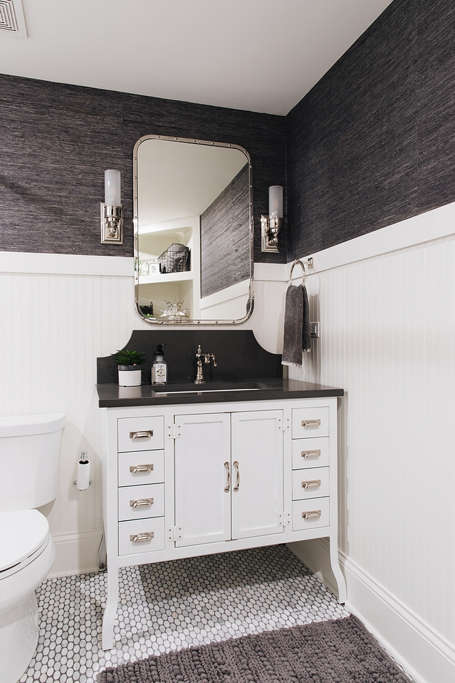 Bathroom with beadboard wainscoting, Metal Bathroom Vanity, wallpaper and oval marble mosaic floor tile #bathroom #beadboardwainscoting #wainscoting #ovalmosaictile #metalvanity