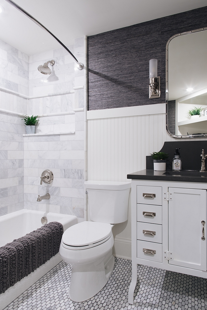 Small Bathroom with beadboard wainscoting marble mosaic floor tile and marble subway tile in tub shower Small Bathroom Small Bathroom #SmallBathroom #Bathroom