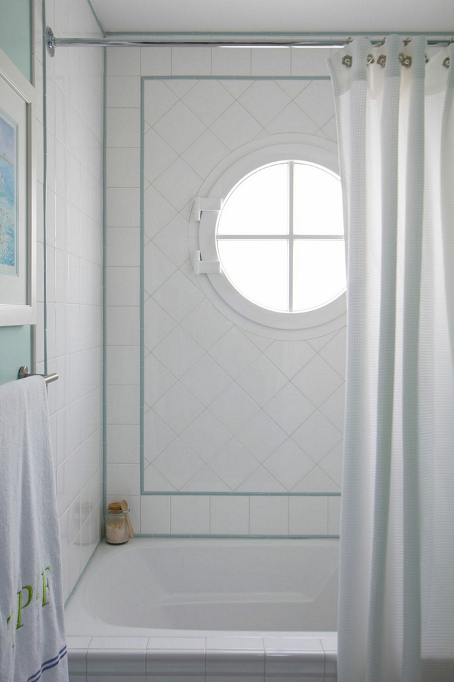 The kids' bathroom features classic 4x4 white subway tile with turquoise accent #kidsbathroom #bathroomtile #4x4tile