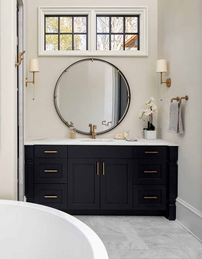 Benjamin Moore Soot Bathroom Navy Cabinet Paint Color Topped with Carrera Marble and painted in Benjamin Moore Soot the vanity just pops #BenjaminMooreSoot