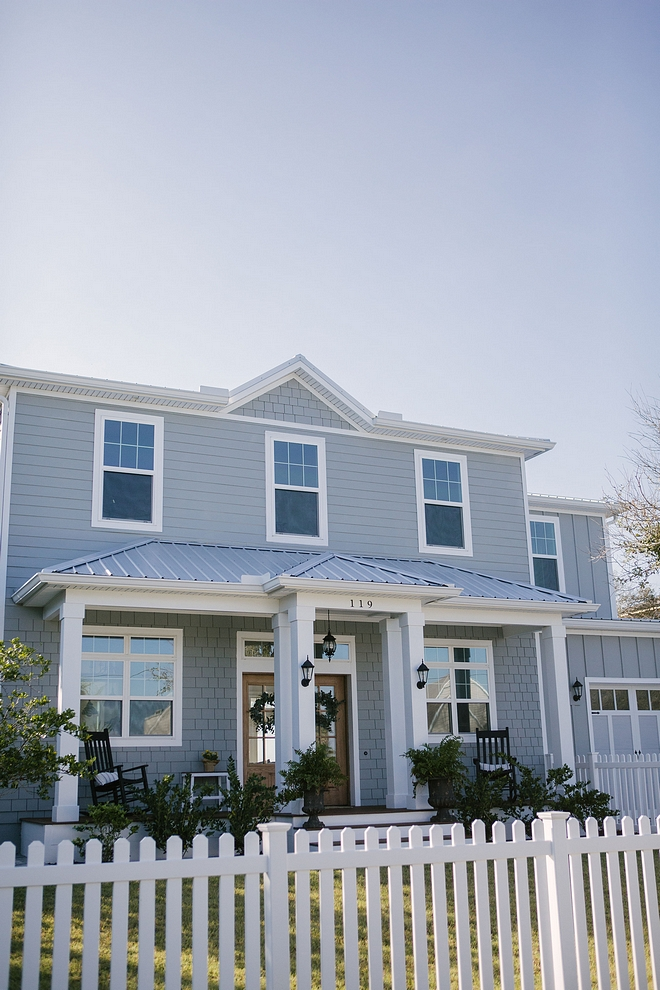 The grey exterior paint color is Behr Sharkskin PPU25-04 Behr Sharkskin Modern farmhouse with grey exterior, white picket fence and metal roof grey exterior paint color is Behr Sharkskin PPU25-04 Behr Sharkskin grey exterior paint color is Behr Sharkskin PPU25-04 Behr Sharkskin #greyexterior #greyexteriorpaintcolor #BehrSharkskinPPU2504 #BehrSharkskin