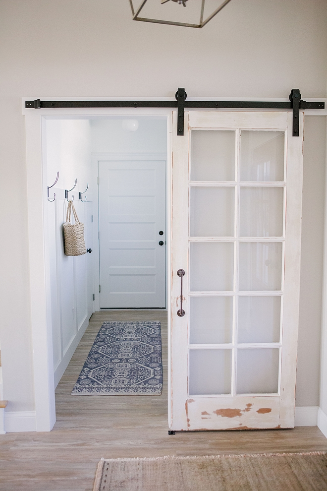 Antique door hung as barn door in laundry room I made sure to incorporate some of my favorite antique and vintage finds into every space of our home, especially the addition of the barn doors #Antiquedoor #barndoor #laundryroom