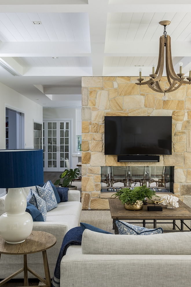Sandstoe fireplace A double-sided Sandstone fireplace separates the living room from the kitchen #sandstone #sandstonefireplace #doublesidedfireplace #fireplace