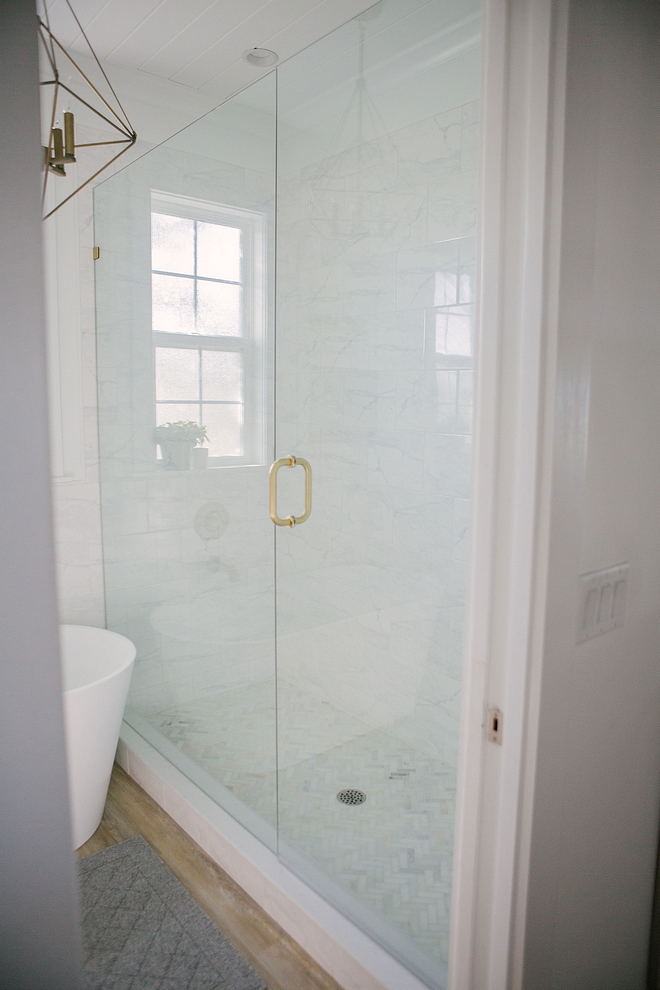 Affordable Shower tile Ideas How to design a shower on a limited budget How to save money when designing a shower Use large tiles on walls and splurge on a marble herringbone tile on shower flooring to balance the look #bathroom #showertile #budget #renovation