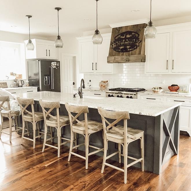 Farmhouse kitchen with white perimeter cabinets and a long farmhouse kitchen island #farmhousekitchen #farmhousekitchenisland #farmhouseisland