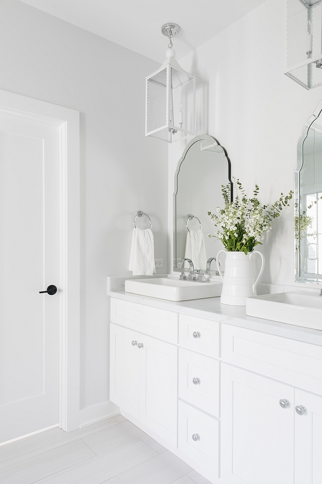 Sherwin Williams Extra White Bathroom cabinet is painted in Sherwin Williams Extra White Sherwin Williams Extra White #sherwinWilliamsExtraWhite