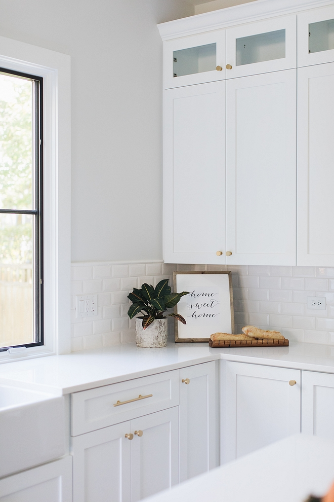 Kitchen with white cabinet white quartz countertop and 3x6 Bevel Square Edge Field White Glossy tile White kitchen Backplash #Kitchen #whitecabinet #whitequartz #countertop #3x6Beveltile #WhiteGlossy #beveltile