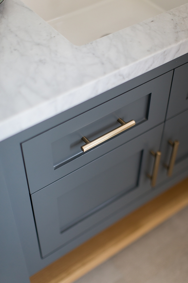 Grey cabinet with Satin Brass hardware