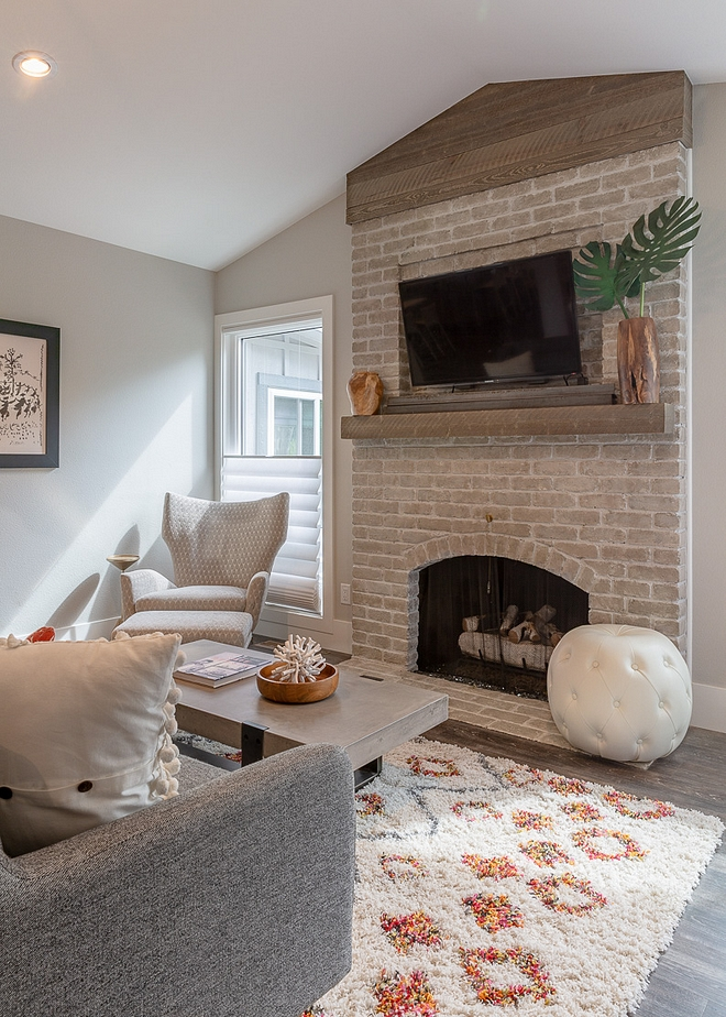 "Original brick fireplace remodel The original brick fireplace had the brick ""whitewashed"" and a reclaimed wood beam was added See the before pictures on Home Bunch #originalbrickfireplace #brickfireplace #brick #fireplace"