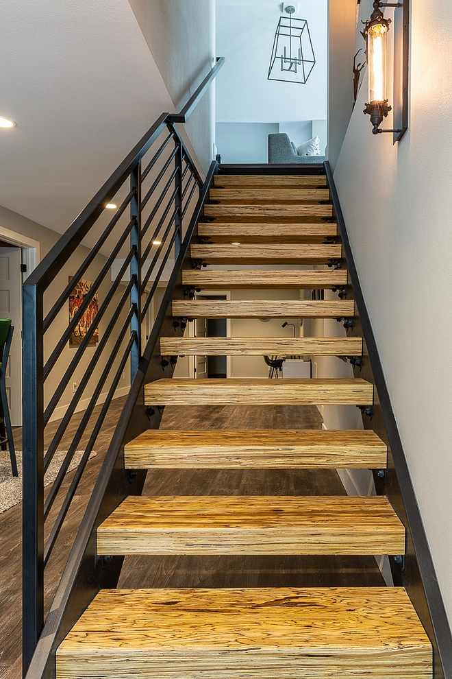 Metal staircase The staircase was replaced with a custom metal staircase with beam treads in a clear finish The beam treads are an engineered laminate lumber, often used as structural beams and posts #Metalstaircase #beams #treads