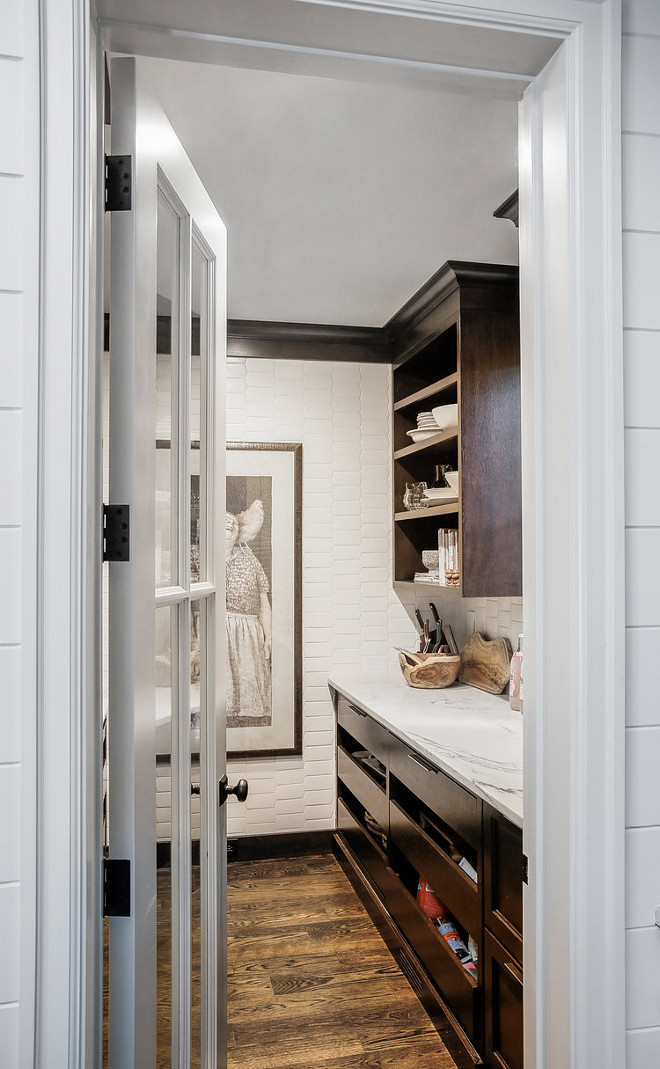 Farmhouse Pantry Farmhouse walk in pantry with elongated picket tile Farmhouse Pantry Farmhouse walk in pantry with elongated picket tile and dark stained wood cabinets #FarmhousePantry #pantry #walkinpantry #elongatedpickettile #Farmhouse #pantry #kitchenpantry