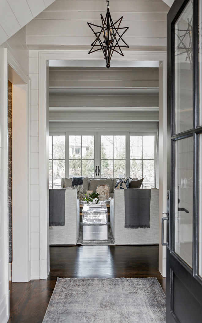Modern Farmhouse Foyer Modern Farmhouse Foyer with shiplap clad walls and black front door #ModernFarmhouseFoyer #ModernFarmhouse #Foyer #shiplap #blackfrontdoor