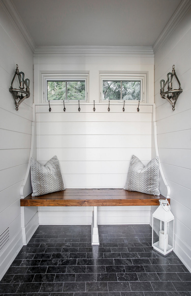 Small Mudroom Ideas Tucked into a nook, the mudroom bench features a custom chunky Knotty Pine bench and beautiful millwork Small mudroom Small mudroom #Smallmudroom #mudroom #bench #mudroombench