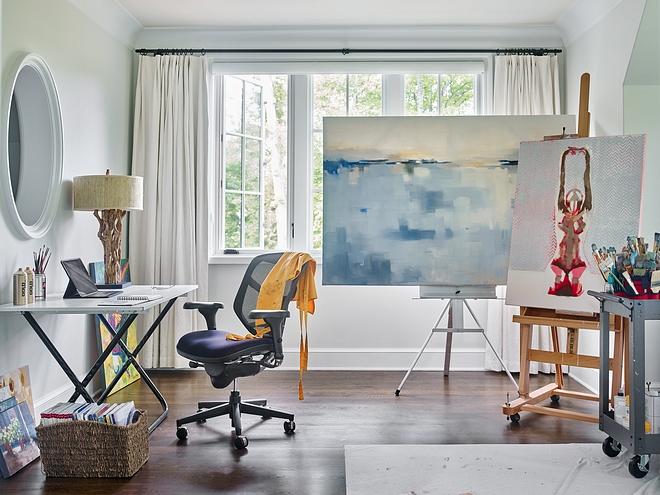 Casement windows bring an abundant amount of natural light to the homeowner's art studio #artstudio