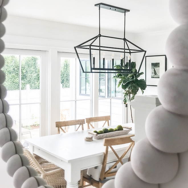 Dining room with affordable linear chandelier Coastal farmhouse dining room lighting Best lighting for dining rooms #Diningroom #affordablelinearchandelier #linearchandelier #Coastalfarmhouse #diningroom #lighting