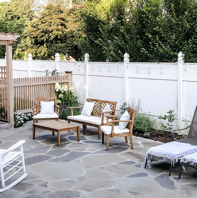 Bluestone patio Random size natural Bluestone patio Patio with Bluestone stone and white fence Bluestone stone patio ideas #Bluestonepatio #bluestone #patio #stonepatio
