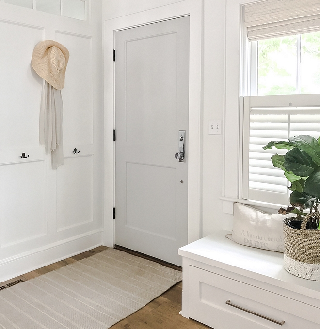 "Foyer Mudroom Ideas When winter rolls around, this becomes the hardest working little corner of our house We create a ""mudroom"" on this wall using board and batten and some simple wall hooks #mudroom #foyer #entry #entryway #boardandbatten"