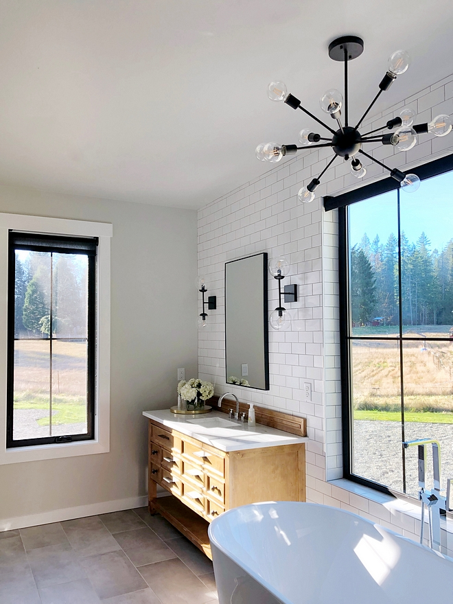 Sherwin Williams Agreeable Gray with white subway tile and grey floor tile Sherwin Williams Agreeable Gray Sherwin Williams Agreeable Gray Paint Color Sherwin Williams Agreeable Gray Sherwin Williams Agreeable Gray #SherwinWilliamsAgreeableGray