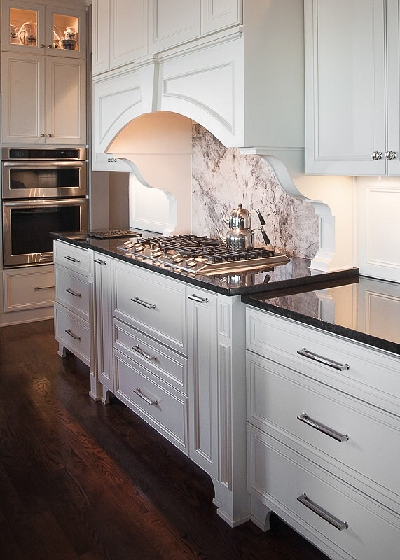 Kitchen Hood Corbels Traditional white kitchen with white curved kitchen hood accented with corbels and Quartzite slab backsplash Countertop is Black granite Kitchen Hood Corbels Traditional white kitchen with white curved kitchen hood #KitchenHoodCorbels #hoodcorbels #kitchencorbels #kicthen #kitchen #corbels #Traditionalwhitekitchen #curvedkitchenhood