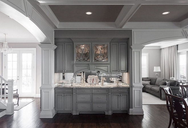 Grey Hutch Kitchen Hutch This grey hutch and the breakfast room are located on the other side of the kitchen. Notice the coffered ceiling, painted in Benjamin Moore Cobblestone, and the family room on the right #hutch #greyhutch #BenjaminMooreCobblestone