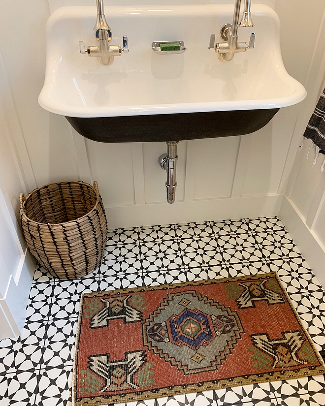 Powder room with cement tile, vintage runner and mounted sink over board and batten paneling #poderroom #cementtile #vintagerunner #wallmountedsink #boardandbatten