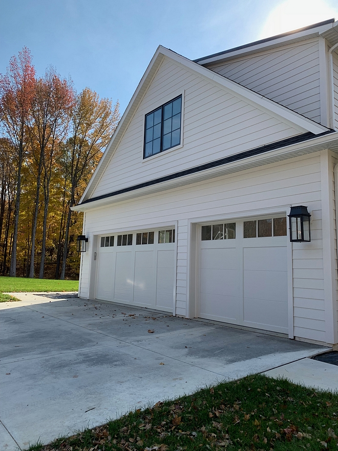 Garage Doors Coachman garage Doors with black metal windows, white siding and black outdoor sconces Garage Doors Coachman Garage Doors Coachman #GarageDoors #Coachman #Coachmangaragedoor #garagedoor #whitesiding #blackwindows #whitehomes #outdoorsconces #blacksconces #garage