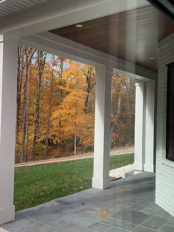 Pennsylvania Bluestone We chose Pennsylvania Blue stone for the flooring and tongue and groove stained Poplar to warm up our white exterior Pennsylvania Blue stone #PennsylvaniaBluestone #Bluestone #porchtile #porch #tile