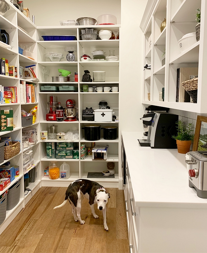 Pantry Pantry with countertop Pantry with cabinets We placed a countertop in here to keep our kitchen counters from being cluttered with appliances, like a toaster and mixer We also added big drawers underneath for easy snack access for the kids #Pantry #Pantrycountertop #Pantrycabinetry