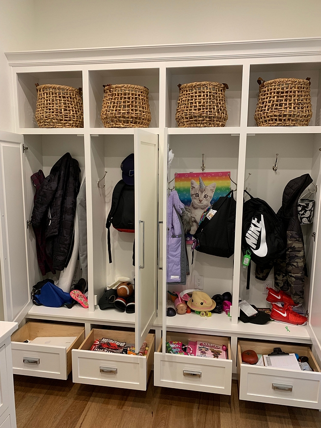 Mudroom Lockers with doors and drawers The insides are always messy, but at least with the doors that space stays looking clutter free. We added drawers on the bottoms for shoes, art supplies, and knick knacks. I'm all about hiding my mess We also added an outlet in each locker for electronic charging #mudroom #lockers