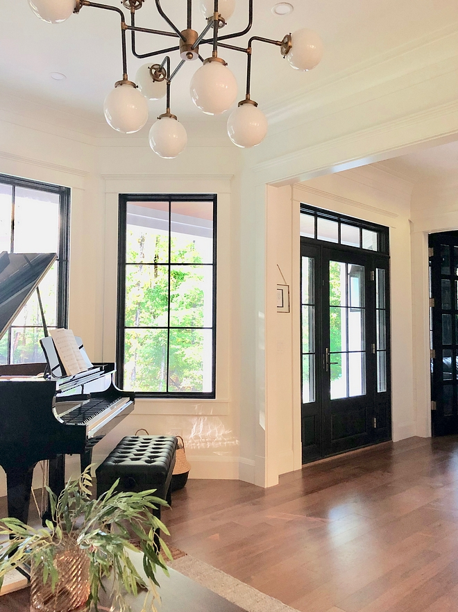 White walls with black windows and black doors Paint color is Black Magic by Sherwin Williams White walls with black windows and black doors Paint color is Black Magic by Sherwin Williams #Whitewalls #blackwindows #blackdoors #Paintcolor #BlackMagicbySherwinWilliams