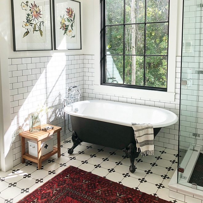 Black and white bathroom We knew we wanted a clawfoot tub to add that vintage feel Black and white clawfoot tub with white subway wainscoting tile, black and white cement floor tile and black window #Blackandwhitebathroom #bathroom