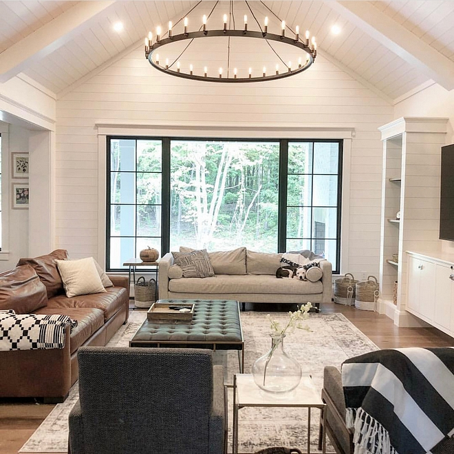 Shiplap Ceiling Our goal in our living room was to create a light and bright atmosphere that still felt warm and cozy Instead of doing an originally designed two story Great Room, we changed it to a vaulted 15.5 ft ceiling covered in shiplap We wanted the black chandelier to be a focal point, as well as the black window #shiplapceiling #shiplap #ceiling