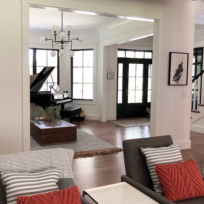 Benjamin Moore Chantilly Lace white walls with black windows and black doors Best white to be used with black windows #BenjaminMooreChantillyLace