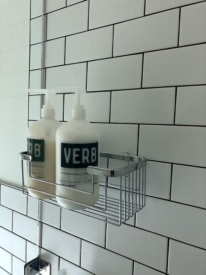 Shower with matte white subway tile and black grout