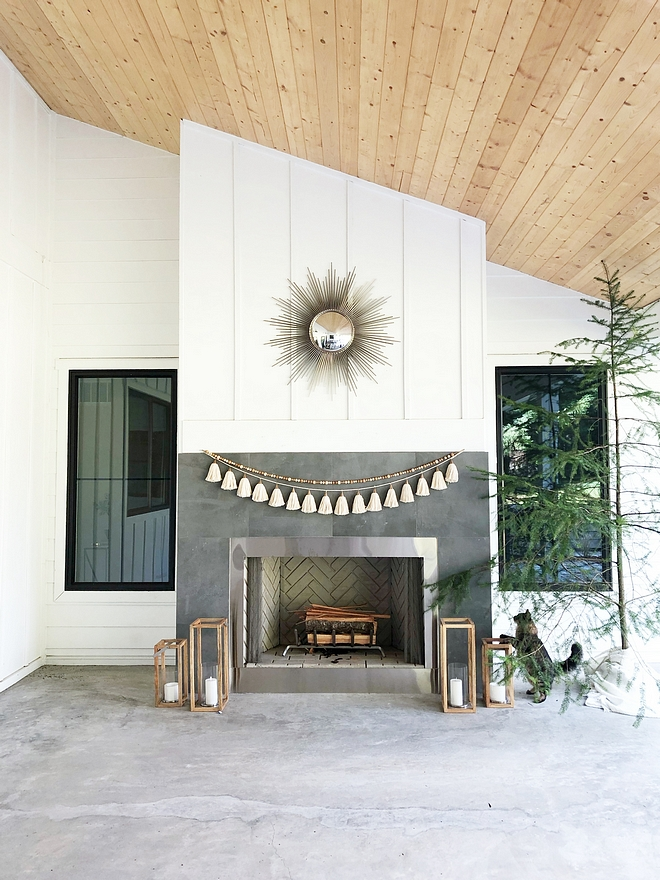 The outdoor fireplace mimics the living room's fireplace, featuring the same tiling and board and batten paneling #fireplacetiling #outdoorfireplace #fireplace #boardandbatten