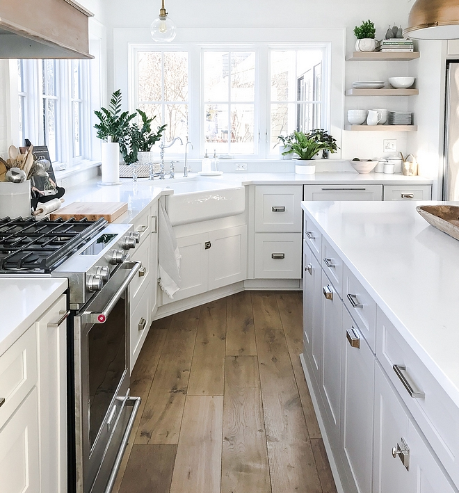 White kitchen with off white cabinets, white marble Quartz countertop, Martha Stewart cabinet hardware and wide plank hardwood flooring #whitekitchen #kitchen #classicwhitekitchen #classickitchen #kitchens #whitekitchens #kitchens #shakerkitchen