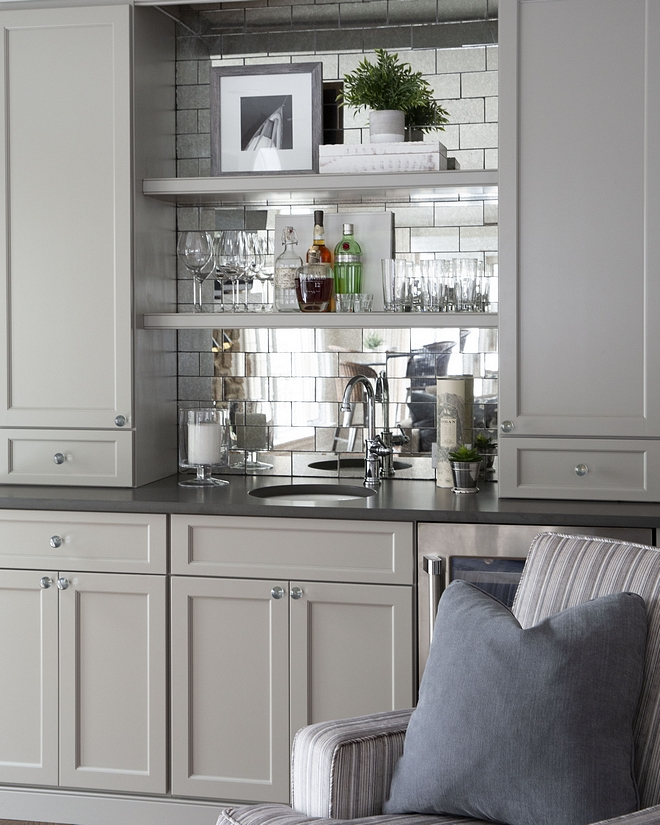 Benjamin Moore Hearthstone The bar cabinet is painted in Benjamin Moore Hearthstone and it features antique mirror glass subway tile and honed Alleanza Gotham Grey quartz countertop Benjamin Moore Hearthstone #BenjaminMooreHearthstone