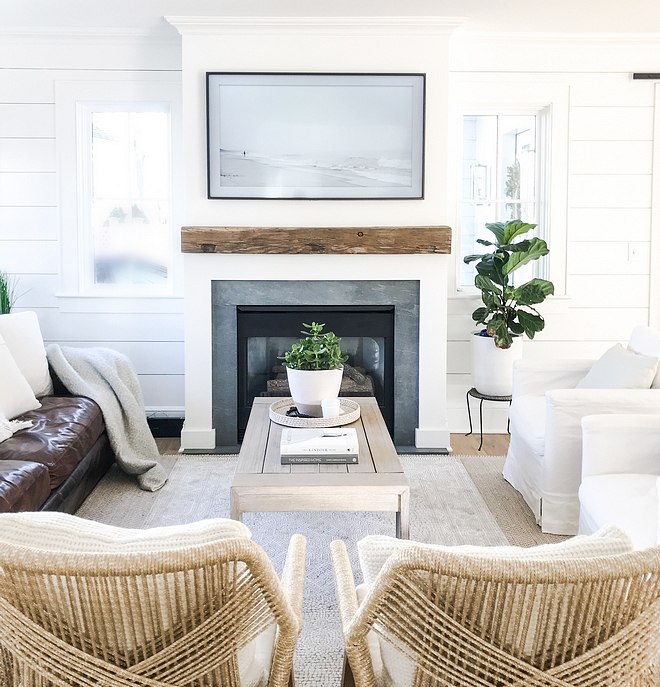 All interior walls and trim are painted in Benjamin Moore Super White Fireplace surround is Pietro Cardosa and the beam is reclaimed chestnut
