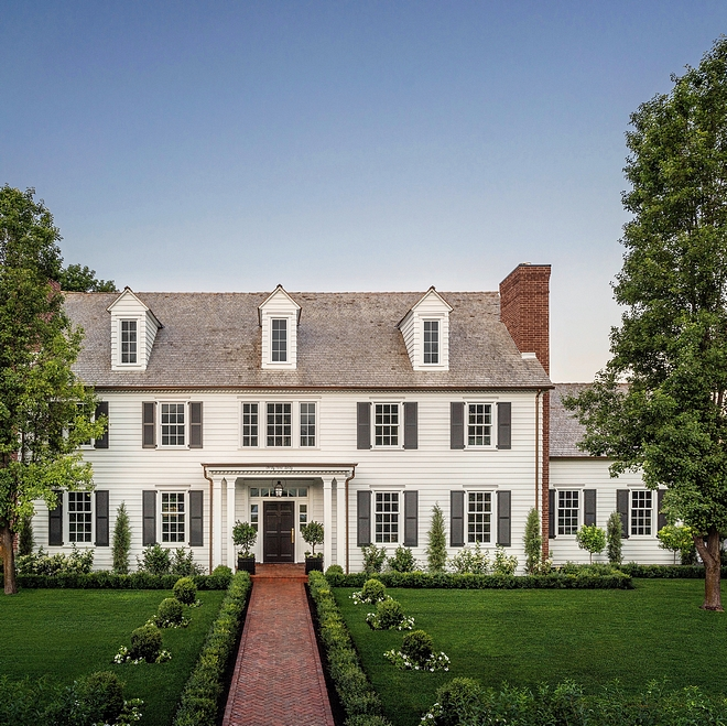 White Classic Colonial Home with Black shutters, herringbone brick pathway and brick chimney #ClassicColonial #ColonialHome #Blackshutters #herringbonebrick #brickpathway #pathway #brickchimney