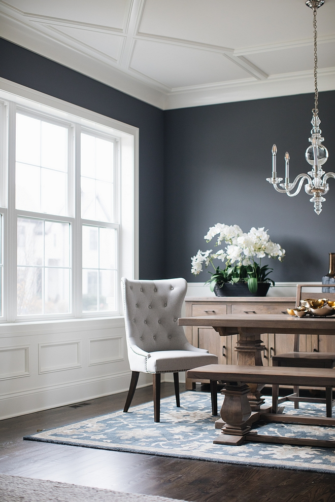 White wainscoting , trim and ceiling paint color is Benjamin Moore Simply White with dark charcoal walls painted in Benjamin Moore Charcoal Slate #BenjaminMooreSimplywhite #trim #wainscoting #ceiling #millwork #Darkcharcoaldiningroom #diningroom #wallpaintcolor