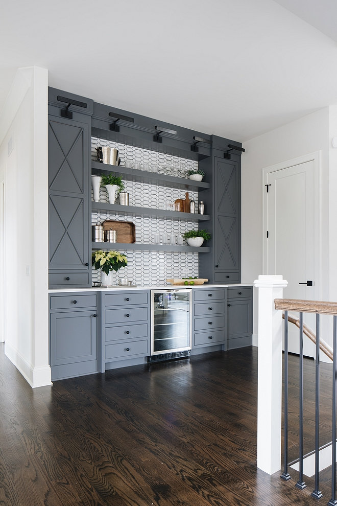 Grey bar cabinet This home also features an oversized built-in bar with beverage fridge and floating shelves Bar #Greybarcabinet #barcabinet #greycabinet #bar #cabinet